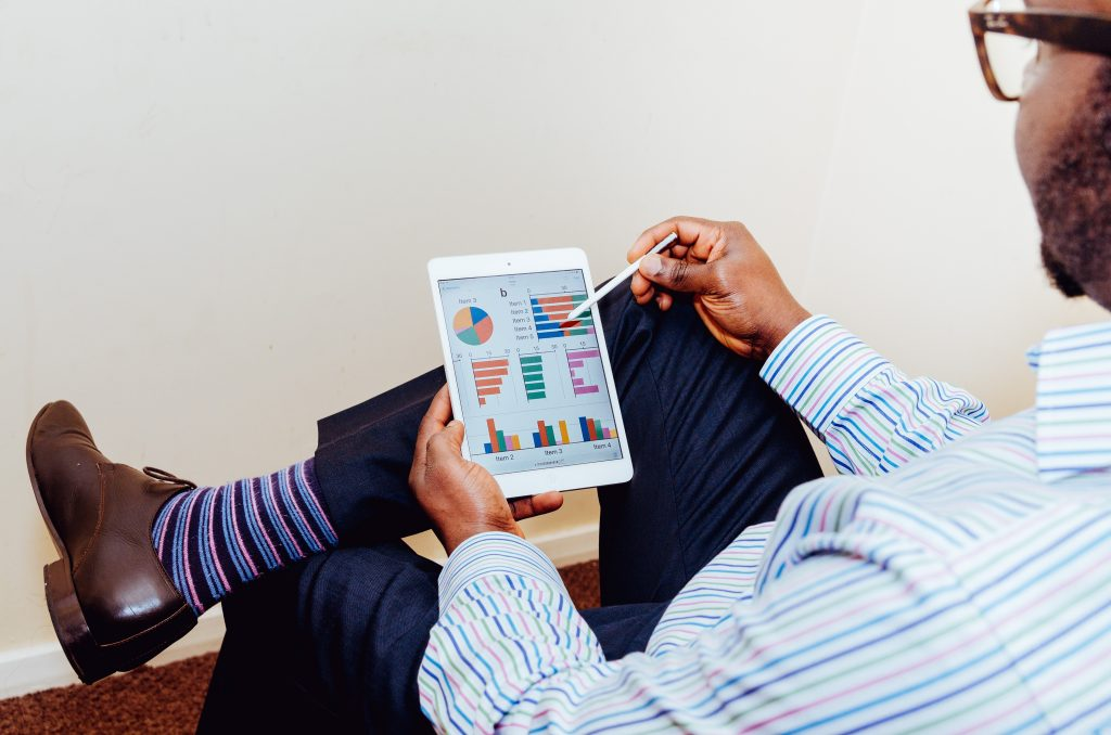 image of a man checking graphs